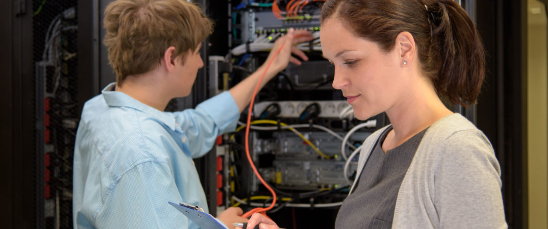 43324792 - team of it specialists in datacenter working by network servers